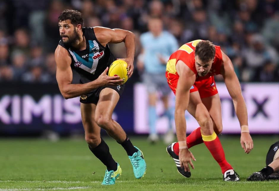ADELAIDE, AUSTRALIA - AUGUST 26: Paddy Ryder of the Power breaks away from Keegan Brooksby of the Suns during the 2017 AFL round 23 match between the Port Adelaide Power and the Gold Coast Suns at Adelaide Oval on August 26, 2017 in Adelaide, Australia. (Photo by AFL Media)