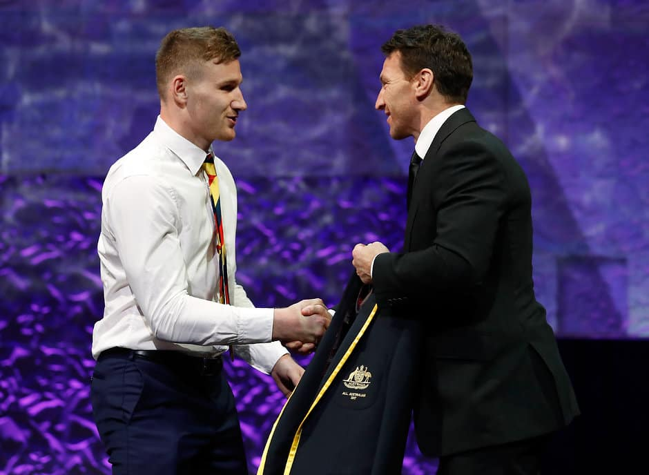 MELBOURNE, AUSTRALIA - AUGUST 30: Rory Laird of the Crows is presented with his blazer by Brent Harvey during the 2017 Virgin Australia AFL All Australian Awards at the Palais Theatre on August 30, 2017 in Melbourne, Australia. (Photo by Adam Trafford/AFL Media)