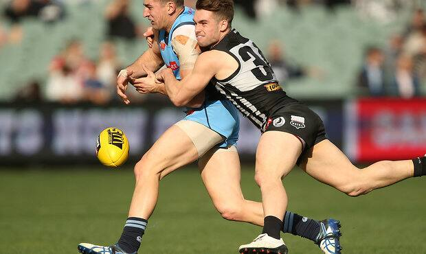 ADELAIDE, AUSTRALIA - SEPTEMBER 2: Patrick Wilson of the Blues is tackled by William Snelling of the Magpies during the SANFL Qualifying Final between Port Adelaide and Sturt at Adelaide Oval on September 2, 2017 in Melbourne, Australia. (Photo by James Elsby/AFL Media)