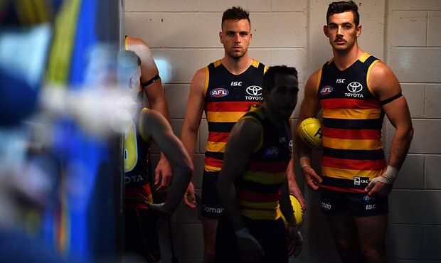 ADELAIDE, AUSTRALIA - SEPTEMBER 07: Taylor Walker of the Crows prepares to lead his players onto the ground during the AFL First Qualifying Final match between the Adelaide Crows and the Greater Western Sydney Giants at Adelaide Oval on September 7, 2017 in Adelaide, Australia.  (Photo by Daniel Kalisz/Getty Images/AFL Media)