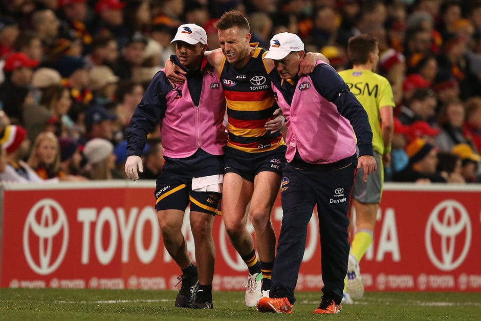 ADELAIDE, AUSTRALIA - SEPTEMBER 07: Brodie Smith of the Crows goes off injured during the 2017 AFL First Qualifying Final match between the Adelaide Crows and the GWS Giants at the Adelaide Oval on September 07, 2017 in Adelaide, Australia. (Photo by James Elsby/AFL Media)