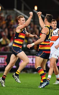 ADELAIDE, AUSTRALIA - SEPTEMBER 07: (L-R) Tom Lynch and Taylor Walker of the Crows celebrate after scoring a goal during the AFL First Qualifying Final match between the Adelaide Crows and the Greater Western Sydney Giants at Adelaide Oval on September 7, 2017 in Adelaide, Australia.  (Photo by Daniel Kalisz/Getty Images/AFL Media)