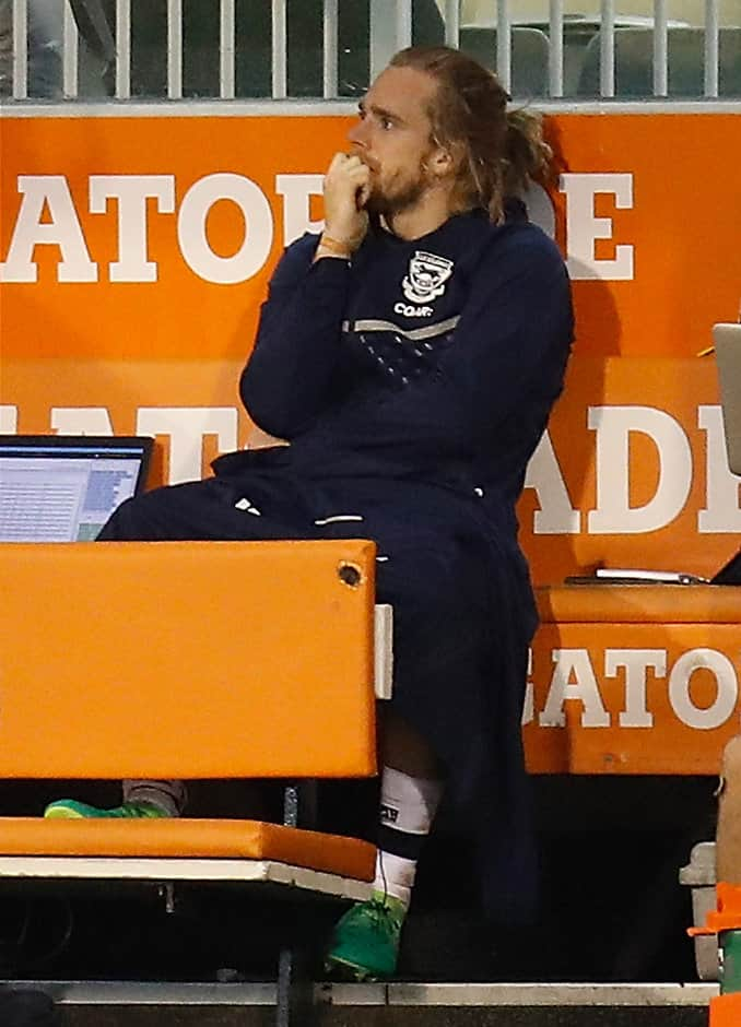 Cam Guthrie looks on after suffering a calf injury - AFL,Geelong Cats,GWS Giants