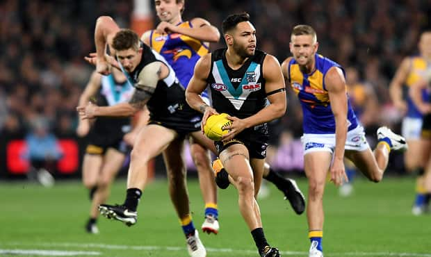 ADELAIDE, AUSTRALIA - SEPTEMBER 09:  Jarman Impey gets the ball out the centre during the AFL First Elimination Final match between Port Adelaide Power and West Coast Eagles at Adelaide Oval on September 9, 2017 in Adelaide, Australia.  (Photo by Mark Brake/AFL Media/Getty Images)