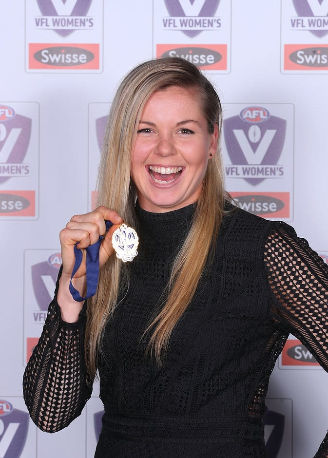 Kate Brennan with her VFL best and fairest award on Monday evening - AFLW