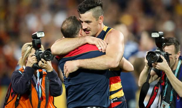 ADELAIDE, AUSTRALIA - SEPTEMBER 22: Don Pyke, Senior Coach of the Crows celebrates victory with Taylor Walker during the 2017 AFL First Preliminary Final match between the Adelaide Crows and the Geelong Cats at Adelaide Oval on September 22, 2017 in Adelaide, Australia. (Photo by AFL Media)