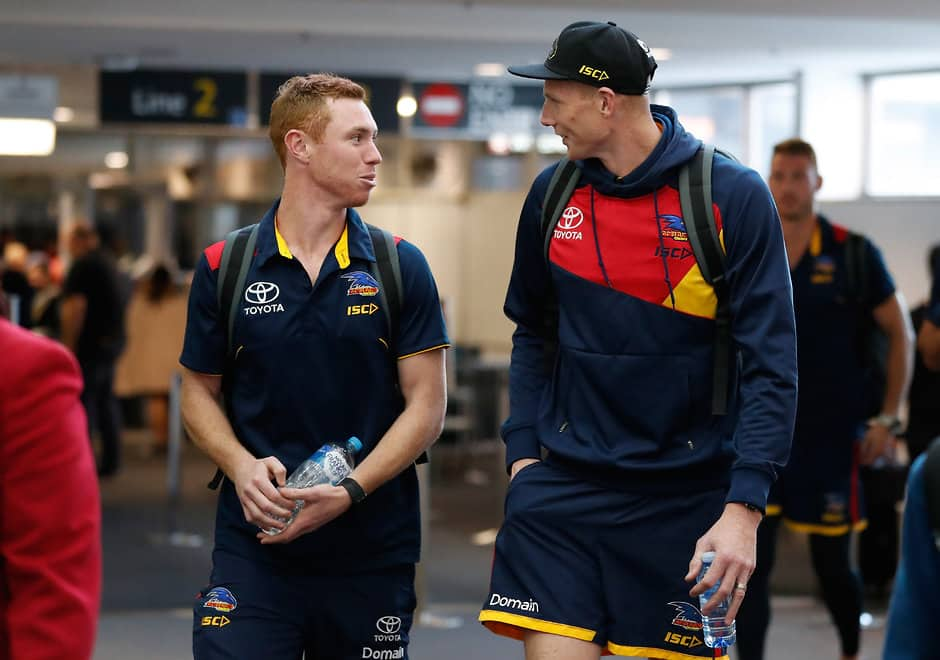 MELBOURNE, AUSTRALIA - SEPTEMBER 28: Tom Lynch (left) and Sam Jacobs of the Crows look on as the Adelaide Crows arrive at Melbourne Airport ahead of the Grand Final against Richmond on September 28, 2017 in Melbourne, Australia. (Photo by Michael Willson/AFL Media)