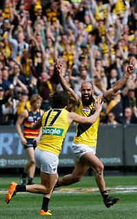Bachar Houli celebrates another goal for the Tigers with Daniel Rioli