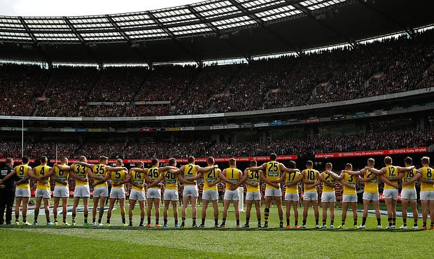 Richmond line up for the national anthem ahead of the 2017 AFL Grand Final  - Richmond Tigers,Grand Final