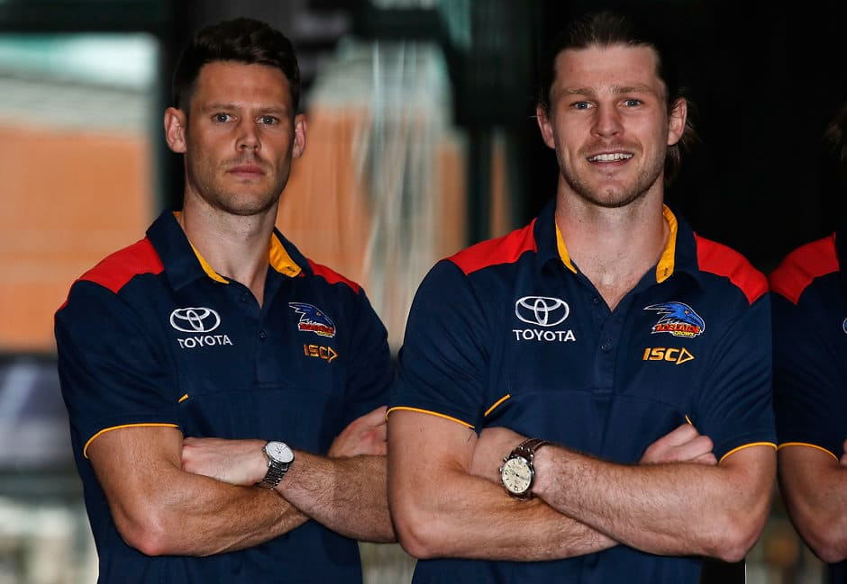 MELBOURNE, AUSTRALIA - OCTOBER 19: New Crows recruits Bryce Gibbs and Sam Gibson (right) pose for a photograph during an Adelaide Crows press conference at the Nixon Hotel on October 19, 2017 in Melbourne, Australia. (Photo by Michael Willson/AFL Media)