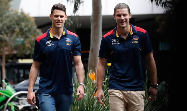 MELBOURNE, AUSTRALIA - OCTOBER 19: New Crows recruits Bryce Gibbs and Sam Gibson (left) pose for a photograph during an Adelaide Crows press conference at the Nixon Hotel on October 19, 2017 in Melbourne, Australia. (Photo by Michael Willson/AFL Media)