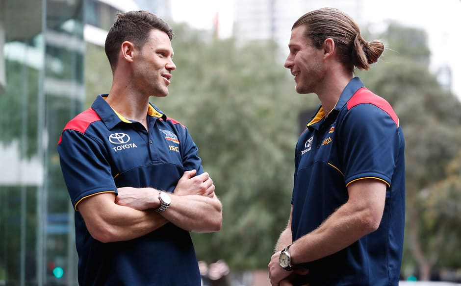 MELBOURNE, AUSTRALIA - OCTOBER 19: New Crows recruits Bryce Gibbs (right) and Sam Gibson chat during an Adelaide Crows press conference at the Nixon Hotel on October 19, 2017 in Melbourne, Australia. (Photo by Michael Willson/AFL Media)