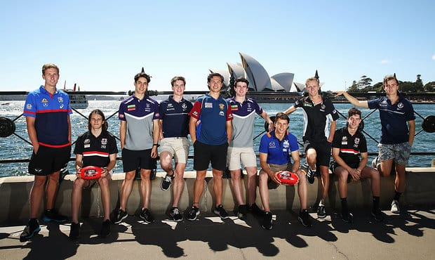 SYDNEY, AUSTRALIA - NOVEMBER 25:  (L-R) Aaron Naughton of the Bulldogs, Hunter Clark of the Saints, Adam Cerra of the Dockers, Paddy Dow of the Blues, Cameron Rayner of the Lions, Andrew Brayshaw of the Dockers, Luke Davies-Uniacke of the Kangaroos, Jaiyden Stephenson of the Magpies, Nicholas Coffield of the Saints and Lochie O'Brien of the Blues pose during a media opportunity at Hickson Road Reserve on November 25, 2017 in Sydney, Australia.  (Photo by Brendon Thorne/AFL Media/Getty Images)