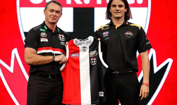 SYDNEY, AUSTRALIA - NOVEMBER 24: Pick number 7 Hunter Clark of the Saints poses with Alan Richardson, Senior Coach of the Saints during the 2017 NAB AFL Draft at Sydney Showground on 24 November, 2017 in Sydney, Australia. (Photo by Adam Trafford/AFL Media) (Editors note: This image is free for editorial use only)