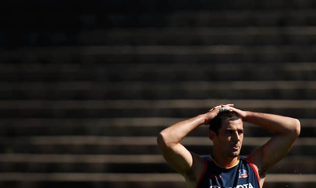 Taylor Walker will spend two weeks in a moon boot after straining his plantar fascia