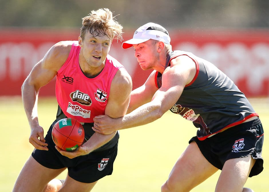 Hugh Goddard tries to break a Seb Ross tackle at pre-season training - AFL,Injuries,St Kilda Saints,Hugh Goddard
