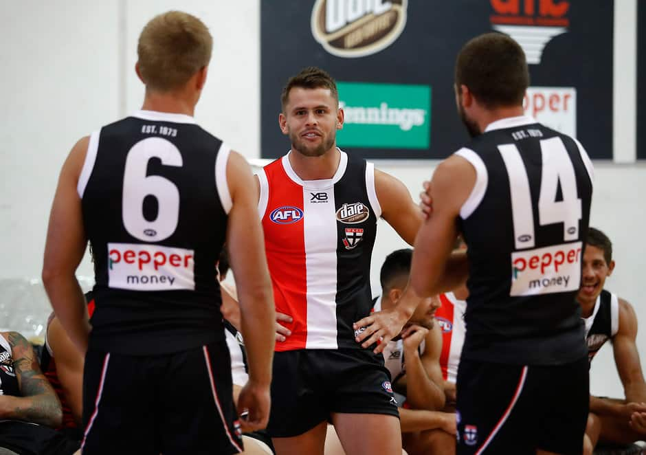 MELBOURNE, AUSTRALIA - FEBRUARY 2: Maverick Weller of the Saints (middle) chats to Sebastian Ross (left) and Jarryn Geary of the Saints during the St Kilda Saints team photo day at Linen House Centre on February 2, 2018 in Melbourne, Australia. (Photo by Adam Trafford/AFL Media)