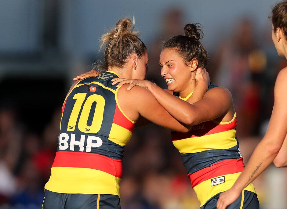 ADELAIDE, AUSTRALIA - FEBRUARY 3: Ruth Wallace of the Crows celebrates a goal with team mate Ebony Marinoff during the 2018 AFLW Round 01 match between the Adelaide Crows and the Brisbane Lions at Norwood Oval on February 3, 2018 in Adelaide, Australia. (Photo by AFL Media)