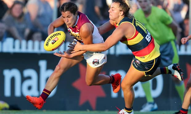 ADELAIDE, AUSTRALIA - FEBRUARY 3: Ally Anderson of the Lions is tackled by Ebony Marinoff of the Crows during the 2018 AFLW Round 01 match between the Adelaide Crows and the Brisbane Lions at Norwood Oval on February 3, 2018 in Adelaide, Australia. (Photo by AFL Media)