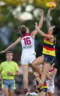 ADELAIDE, AUSTRALIA - FEBRUARY 3: Tahlia Randall of the Lions clashes with Rhiannon Metcalfe of the Crows  during the 2018 AFLW Round 01 match between the Adelaide Crows and the Brisbane Lions at Norwood Oval on February 3, 2018 in Adelaide, Australia. (Photo by AFL Media)
