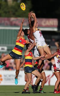 ADELAIDE, AUSTRALIA - FEBRUARY 3: Sharni Webb and Sabrina Frederick-Traub of the Lions fly with Talia Radan and Chelsea Randall of the Crows during the 2018 AFLW Round 01 match between the Adelaide Crows and the Brisbane Lions at Norwood Oval on February 3, 2018 in Adelaide, Australia. (Photo by AFL Media)