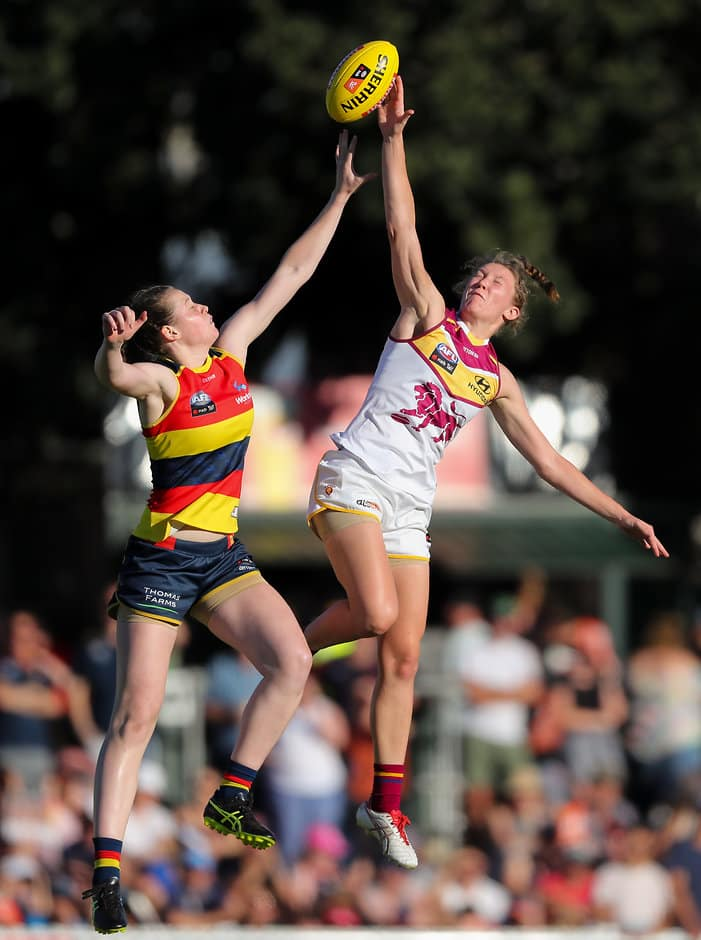 ADELAIDE, AUSTRALIA - FEBRUARY 3: Jess Allan of the Crows clashes with Tahlia Randall of the Lions during the 2018 AFLW Round 01 match between the Adelaide Crows and the Brisbane Lions at Norwood Oval on February 3, 2018 in Adelaide, Australia. (Photo by AFL Media)