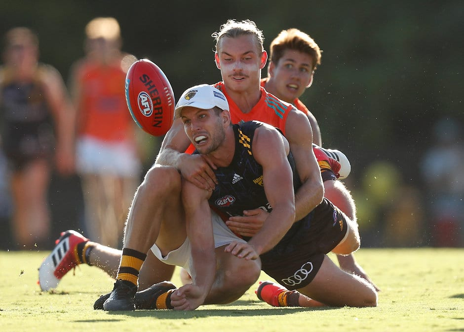 MELBOURNE, AUSTRALIA - FEBRUARY 9: Luke Breust of the Hawks is tackled by teammate James Worpel during the Hawthorn Hawks intra-club at the Ricoh Centre on February 9, 2018 in Melbourne, Australia. (Photo by Michael Willson /AFL Media)