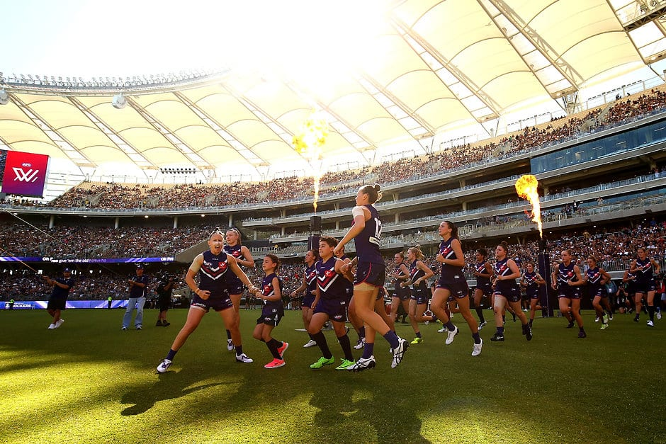 PERTH, AUSTRALIA - FEBRUARY 10: The Dockers run onto the field during the round two AFLW match between the Fremantle Dockers and the Collingwood Magpies at Optus Stadium on February 10, 2018 in Perth, Australia.  (Photo by Paul Kane/Getty Images/AFL Media)