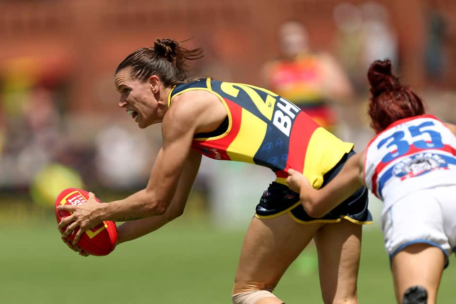 ADELAIDE, AUSTRALIA - FEBRUARY 17: Chelsea Randall of the Crows is tackled by Jenna Bruton of the Bulldogs during the 2018 AFLW Round 03 match between the Adelaide Crows and the Western Bulldogs at Norwood Oval on February 17, 2018 in Adelaide, Australia. (Photo by James Elsby/AFL Media)