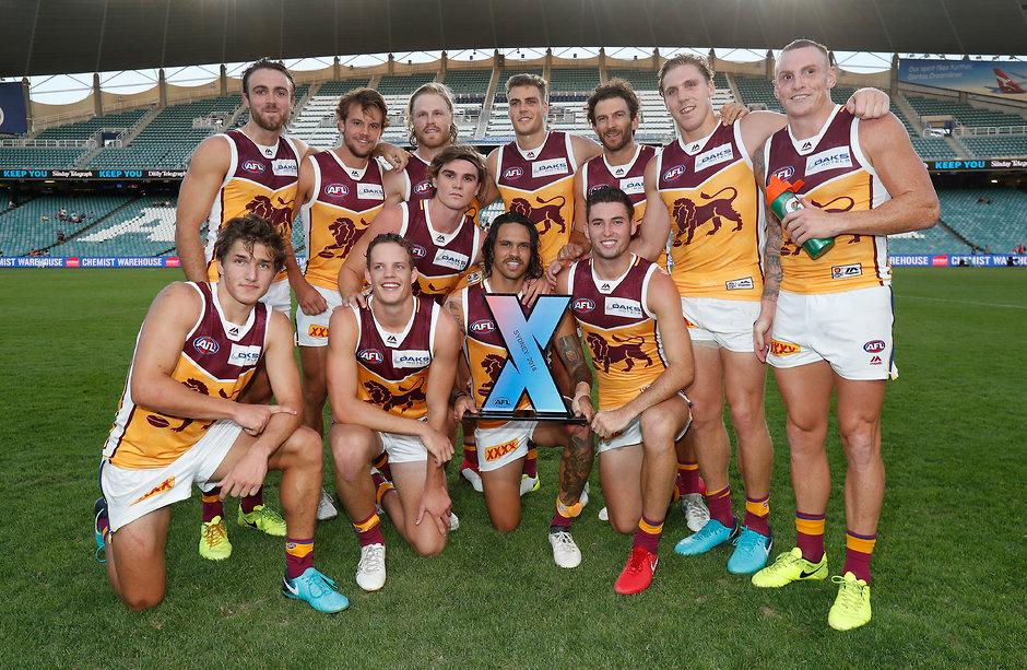 The Lions celebrate their win at AFLX Sydney - AFLX,Brisbane Lions,Dayne Zorko