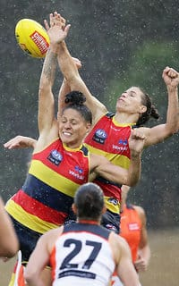 SYDNEY, AUSTRALIA - FEBRUARY 25:  Stevie-Lee Thompson (L) and Chelsea Randall (R) of the Crows compete for the ball during the round four AFLW match between the Greater Western Sydney Giants and the Adelaide Crows at Blacktown International Sportspark on February 25, 2018 in Sydney, Australia.  (Photo by Matt King/Getty Images/AFL Media)