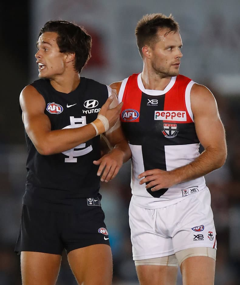 MELBOURNE, AUSTRALIA - FEBRUARY 28: Jack Silvagni of the Blues and Nathan Brown of the Saints lookson during the AFL 2018 JLT Community Series match between the Carlton Blues and the St Kilda Saints at Ikon Park on February 28, 2018 in Melbourne, Australia. (Photo by Michael Willson/AFL Media)