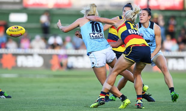 ADELAIDE, AUSTRALIA - MARCH 03:  Erin Phillips of the Adelaide Crows gets Sarah Hosking of Carlton  high during the round five AFLW match between the Adelaide Crows and the Carlton Blues at Norwood Oval on March 3, 2018 in Adelaide, Australia.  (Photo by Mark Brake/Getty Images/AFL Media)