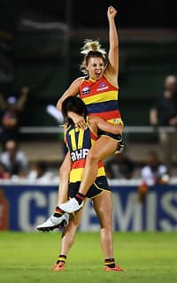 ADELAIDE, AUSTRALIA - MARCH 03:  Ebony Marinoff of the Adelaide Crows and Jessica Sedunary of the Adelaide Crows at the final siren during the round five AFLW match between the Adelaide Crows and the Carlton Blues at Norwood Oval on March 3, 2018 in Adelaide, Australia.  (Photo by Mark Brake/Getty Images/AFL Media)