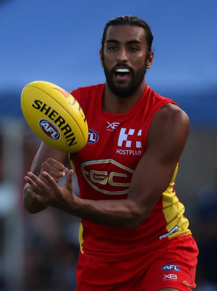TOWNSVILLE, AUSTRALIA - MARCH 4: Tom Nicholls of the Suns in action during the AFL 2018 JLT Community Series match between the Gold Coast Suns and the Geelong Cats at Tony Ireland Stadium on March 4, 2018 in Townsville, Australia. (Photo by Sean Garnsworthy/AFL Media)