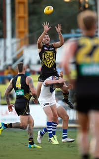Toby Nankervis hauls in a grab during Wednesday night's JLT Series match. - Toby Nankervis,Richmond Tigers,JLT Series