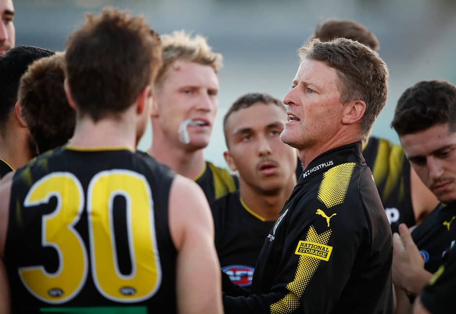 MELBOURNE, AUSTRALIA - MARCH 7: Damien Hardwick, Senior Coach of the Tigers addresses his players during the AFL 2018 JLT Community Series match between the Richmond Tigers and the North Melbourne Kangaroos at Ikon Park on March 7, 2018 in Melbourne, Australia. (Photo by Adam Trafford/AFL Media)