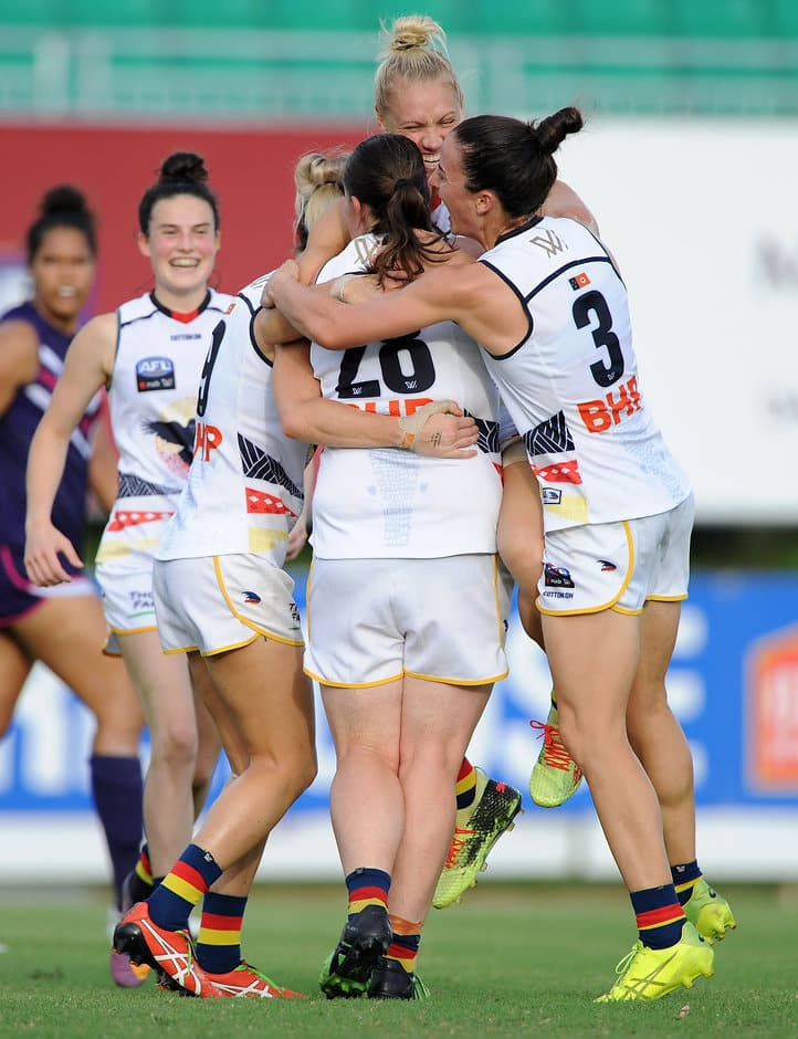 Crows players help Erin Phillips celebrate one of her three goals - AFLW,Adelaide Crows,Fremantle Dockers