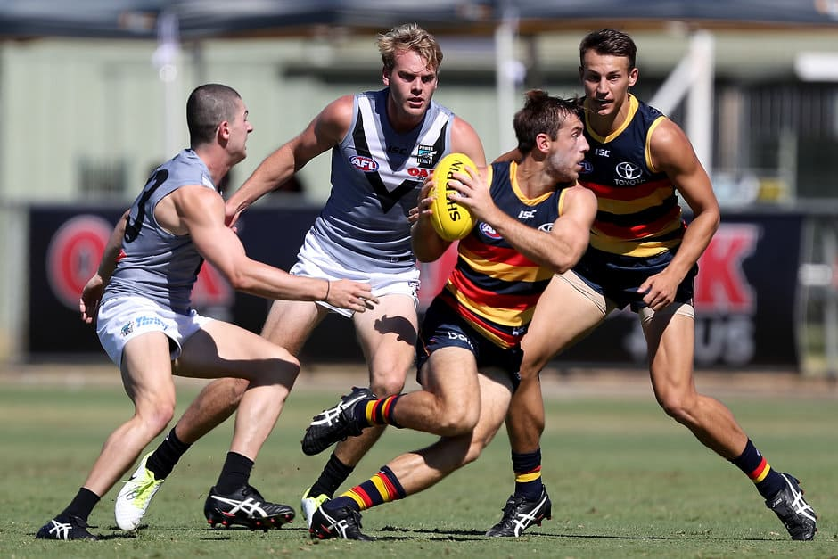 ADELAIDE, AUSTRALIA - MARCH 10: Darcy Byrne-Jones of the Power tackles Richard Douglas of the Crows during the AFL 2018 JLT Community Series match between Port Adelaide and the Adelaide Crows at Alberton Oval on March 10, 2018 in Melbourne, Australia. (Photo by James Elsby/AFL Media)
