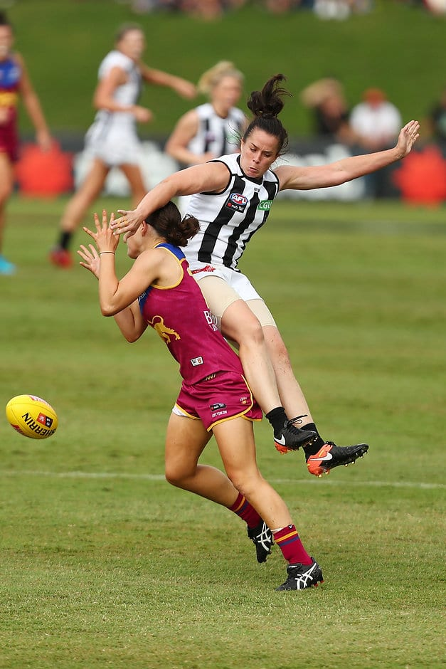 Brisbane Lion Sophie Conway and Collingwood's Tara Morgan compete for the ball - AFLW,Brisbane Lions,Collingwood Magpies,Moreton Bay Central Sports Complex