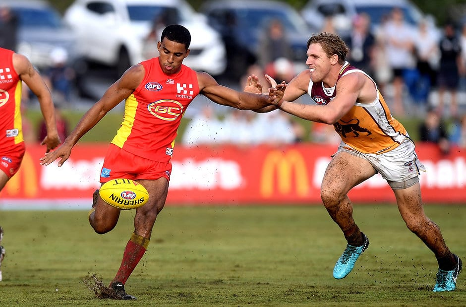 BRISBANE, AUSTRALIA - MARCH 11:  Touk Miller of the Suns gets a kick away during the JLT Community Series AFL match between the Gold Coast Suns and the Brisbane Lions at Fankhauser Reserve on March 11, 2018 in Brisbane, Australia.  (Photo by Bradley Kanaris/Getty Images)
