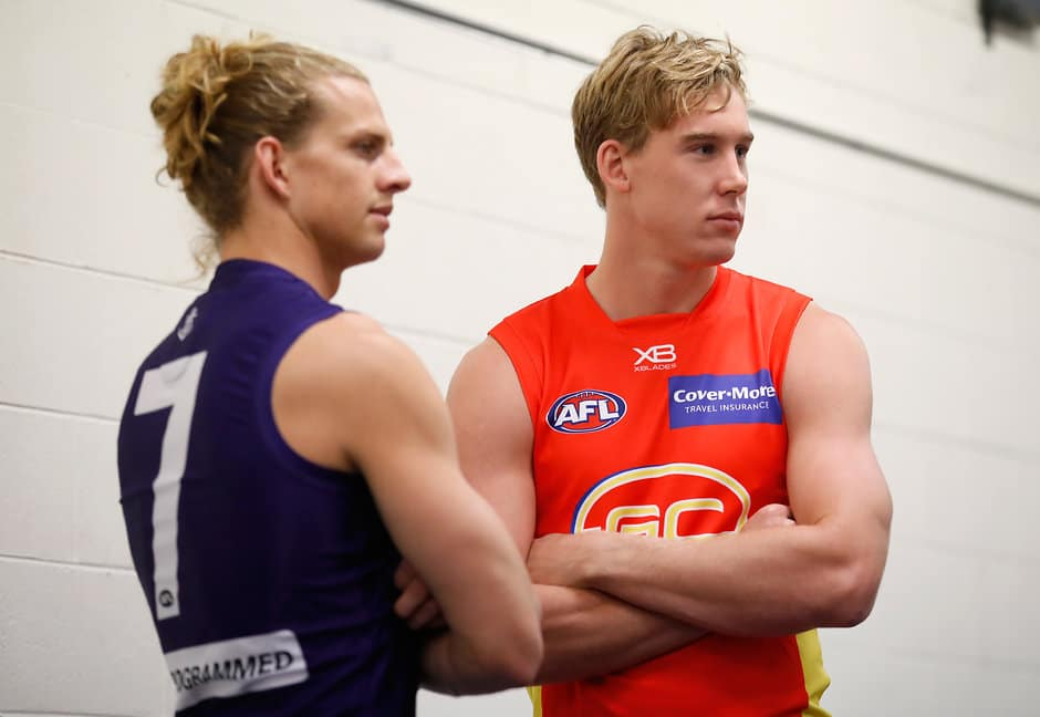 MELBOURNE, AUSTRALIA - MARCH 15: Nat Fyfe of the Dockers and Tom Lynch of the Suns look on during the AFL Captains Day at Etihad Stadium on March 15, 2018 in Melbourne, Australia. (Photo by Michael Willson/AFL Media)