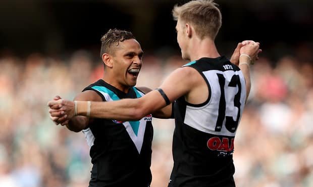 ADELAIDE, AUSTRALIA - MARCH 24: Dom Barry and Todd Marshall of the Power celebrate a goal during the 2018 AFL round 01 match between the Port Adelaide Power and the Fremantle Dockers at Adelaide Oval on March 24, 2018 in Adelaide, Australia. (Photo by James Elsby AFL Media)