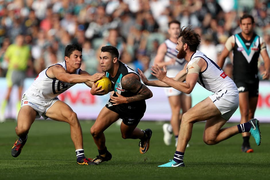 ADELAIDE, AUSTRALIA - MARCH 24: Chad Wingard of the Power out marks Bailey Banfield and Connor Blakely of the Dockers during the 2018 AFL round 01 match between the Port Adelaide Power and the Fremantle Dockers at Adelaide Oval on March 24, 2018 in Adelaide, Australia. (Photo by James Elsby AFL Media)
