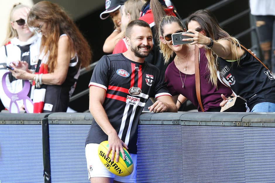 MELBOURNE, AUSTRALIA - MARCH 30:  Jarryn Geary of the Saints poses with fans during the round two AFL match between the North Melbourne Kangaroos and the St Kilda Saints at Etihad Stadium on March 30, 2018 in Melbourne, Australia.  (Photo by Michael Dodge/Getty Images/AFL Media)