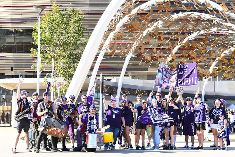 PERTH, AUSTRALIA - MARCH 31: Fremantle fan march arrives at the stadium during the 2018 AFL round 02 match between the Fremantle Dockers and the Essendon Bombers at Optus Stadium on March 31, 2018 in Perth, Australia. (Photo by Daniel Carson/AFL Media)