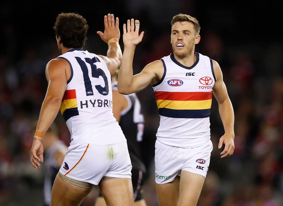 MELBOURNE, AUSTRALIA - APRIL 7: Paul Seedsman of the Crows (right) celebrates a goal with Kyle Hartigan of the Crows during the 2018 AFL round 03 match between the St Kilda Saints and the Adelaide Crows at Etihad Stadium on April 7, 2018 in Melbourne, Australia. (Photo by Adam Trafford/AFL Media)