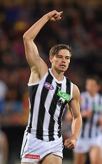 Josh Thomas celebrates a goal against the Crows