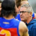 MELBOURNE, AUSTRALIA - APRIL 14:  Chris Fagan, coach of the Lions speaks to players during a break during the round four AFL match between the Richmond Tigers and the Brisbane Lions at Melbourne Cricket Ground on April 14, 2018 in Melbourne, Australia.  (Photo by Brett Hemmings/AFL Media)