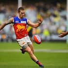 MELBOURNE, AUSTRALIA - APRIL 14:  Dayne Beams of the Lions controls the ball during the round four AFL match between the Richmond Tigers and the Brisbane Lions at Melbourne Cricket Ground on April 14, 2018 in Melbourne, Australia.  (Photo by Brett Hemmings/AFL Media)